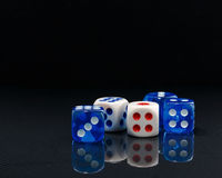 Blue and white dices on the glossy black background Royalty Free Stock Photography