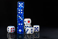 Blue and white dices on the glossy black background Stock Photo