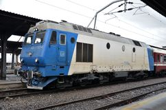 Blue and white diesel electric locomotive: Bucharest Romania Royalty Free Stock Photo