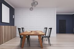 Blue and white dining room, long poster side. Blue and white dining room interior with a wooden floor, a door, and a long horizontal poster above a table with Stock Photo