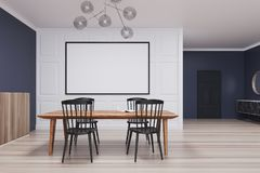 Blue and white dining room, long poster. Blue and white dining room interior with a wooden floor, a door, and a long horizontal poster above a table with chairs Royalty Free Stock Photo