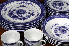 Blue and White Dinnerware. This is an image of blue and white plates and coffee mugs royalty free stock photography