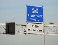 Blue and white direction sign for crossing Ridderkerk on motorway A16 where the ring Rotterdam starts in the Netherlands.  stock photography