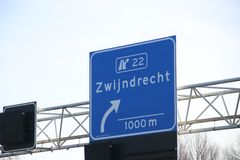 Blue and white direction sign of junction 22 Zwijndrecht on motorway A16 in the Netherlands. Blue and white direction sign of junction 22 Zwijndrecht on royalty free stock images
