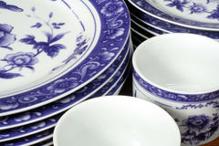 Blue and White Dishes. This is an image of blue and white plates and coffee mugs royalty free stock photo