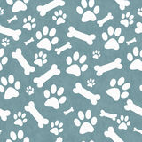 Blue and White Dog Paw Prints and Bones Tile Pattern Repeat Back Stock Images