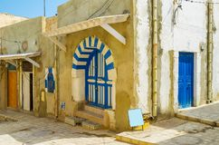 Blue-white door, Sousse, Tunisia. The blue-white arched Arabic door of the house in Medina of Sousse, Tunisia royalty free stock photo