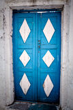 Blue and White Door. Weathered Wooden Door in Greece stock images