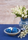 Blue and white Easter decorations on wood, text space Stock Photography