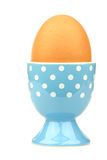 blue and white eggcup with an egg Stock Images