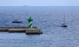 Blue and White Ferry by Green and White Beacon Royalty Free Stock Photo