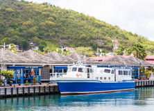 Blue and White Ferry in Port of Marigot Stock Photos