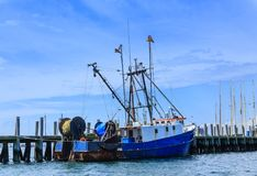 Blue and White Fishing Trawler. At Dock Stock Photos