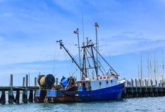 Blue and White Fishing Trawler Stock Photos