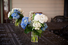 Blue and White Flowers at Wedding Reception Stock Photo
