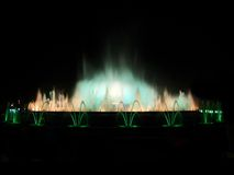 Blue and white fountain. Montjuic magic fountain. A lights,colors and music spectacle at night, displayed in magic fountains situated in Barcelona (Spain Royalty Free Stock Image