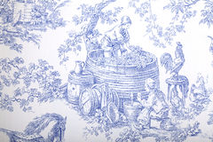Blue and white french baroque pattern wallpaper. Antique blue and white french baroque pattern wallpaper depicts pastoral men and women wine making Stock Photography