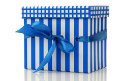 Blue and white gift box with a blue ribbon Stock Photos