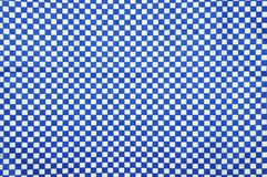 Blue and white gingham cloth background. With fabric texture Stock Image