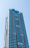 Blue and White Glass Condo Tower Stock Image