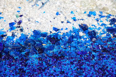 Blue and white glass particles Stock Photography