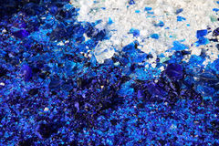 Blue and white glass particles Stock Image