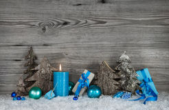 Blue, white and grey Christmas decoration with one burning candl Stock Photos