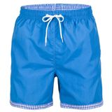 Blue and white with grid pattern men shorts for swimming. Isolated on white background stock photography