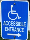 Blue and White Handicap Accessible Sign. Handicap blue and white accessible entrance parking sign Stock Photos