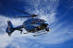 Blue and White Helicopter Stock Image