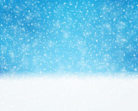 Blue white holiday, winter, Christmas card with snowfall Royalty Free Stock Image