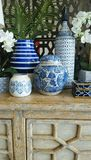 Blue and white homewares. Beautiful ceramic home wares on display on rustic wooden cabinet Royalty Free Stock Photo