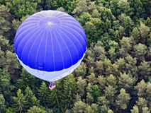 Blue and white hot-air balloon Stock Photo