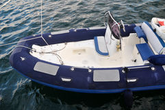 Blue white inflatable boat Stock Image