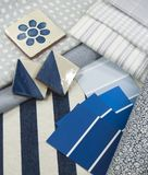 Blue and white interior design plan. Blue and white paint color swatches, fabric and wallpaper samples and ceramic tiles Royalty Free Stock Image
