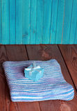 Blue and white knitted pullover with blue gift box Royalty Free Stock Photos