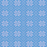 Blue and white knitted snowflakes background stock images