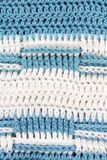 Blue white knitted textured background close up. Stock Image