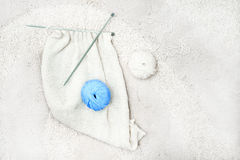 Blue and white knitting wool and knitting needles Royalty Free Stock Image