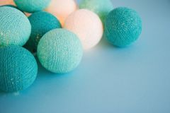 Blue and white light ball made of yarn threads closeup on the blue background. Stock Photos