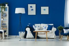 Blue and white living room. Stylish blue and white living room with sofa, table and lamp Stock Photo