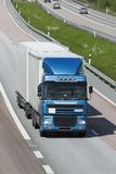 Blue and white lorry Stock Photo