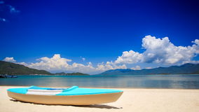 Blue white metal paddle boat on gold sand by azure sea beach stock video footage