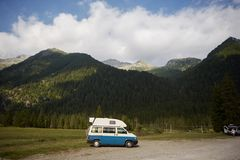 A beautiful bus stands on the background of the mountains royalty free stock photography
