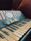 Blue and white mother of pearl accordion 1. Royalty Free Stock Photography