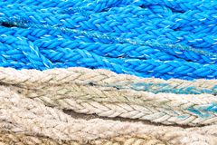 Blue and white nautical rope texture. Naval tackle closeup photo. Summer cruise travel banner. Navy blue and white cordage top view. Seaside pier texture Stock Photography