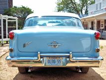 1955 Oldsmobile. A blue and white 1955 Oldsmobile Holiday 88 classic automobile Royalty Free Stock Photo