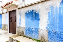Blue & white painted house exterior with splashed paint royalty free stock images