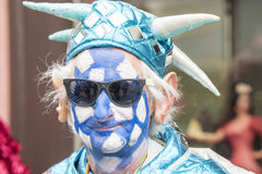 Blue and white painted man at carnival Zurich royalty free stock photo