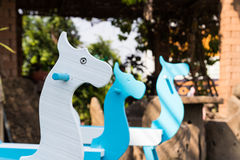 Blue and white painted rocking horse Stock Image